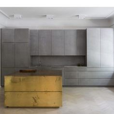 Gold and grey apartment | grey valchromat concrete and brass by Richard Lindvall…
