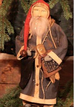 Primitive Santa with Doll - Arnett's Country Store