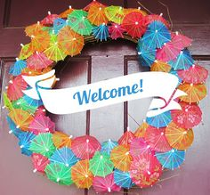 Tiki Hawaiian Party ideas. Cocktail umbrellas make a great wreath! {Made by a Princess Parties in Style}