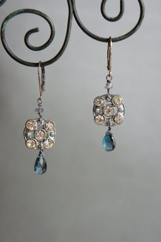 Vintage assemblage earrings, made with vintage potmetal buttons and briolettes of london blue topaz by frenchfeatherdesigns
