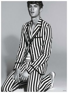 After an initial preview, additional images have been released from Gucci's spring-summer 2015 menswear campaign featuring Mathias Lauridsen. The leading model is photographed by Mert & Marcus for striking black & white campaign images that highlight the Italian fashion house's graphic stripes for the season.    Related