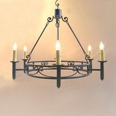 Hand-forged+Spanish+colonial+reproduction+chandelier+with+6+lights.+  Made+of+hand-forged+iron.+The+natural+oxidized+finish+is+then+darkened+with+special+patina+and+sealed+to+last+a+lifetime.+ Includes+antique+candle+covers, 2+feet+of+hand-curled+chain,+hand-hammered+canopy+and+installation+hardware.
