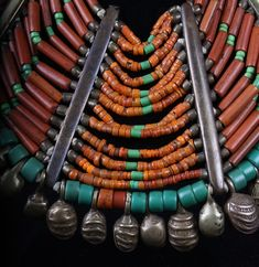 India | Details of superb 19th c. Naga beaded necklace. Origin: Konyak Tribe Materials: beads: (assorted old glass beads, crystal, lapis, turquoise), brass, fiber and shell. It features ancient and rare beads of which are 200-300 years old. This necklace would have been an important heirloom piece of great prestige and value which was worn and handed down to consecutive generations. by hester