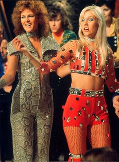 Frida and Agnetha in their tasteful costumes (ahem) while performing Waterloo on Belgian tv in May 1974.