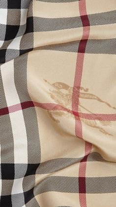 Classic Burberry Scarf... I may need one of these MORE than a new pair of Tiffany earrings!!