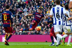 Luis Suarez of FC Barcelona scores his team's second goal during the La Liga match between FC Barcelona and Real Sociedad de Futbol at Camp Nou on November 28, 2015 in Barcelona, Catalonia.