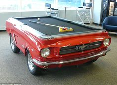 Cue lease of life: Engineers at Florida-based Car Pool Tables sliced their favourite cars like this Mustang in half before kitting them out ...
