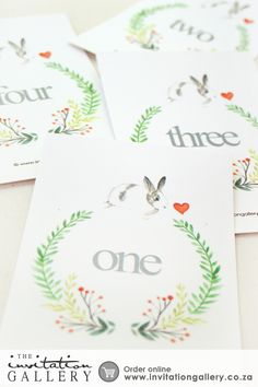 Table Number with hand illustrated watercolour snuggle bunny's and floral wreaths  •	Colours and text are customisable •	Order at:   http://www.invitationgallery.co.za/wedding-invitations-and-stationery/details/ING001-078