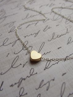 Tiny gold heart necklace - silver and gold necklace - little dainty jewlery. $27.00, via Etsy.
