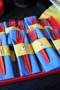 Crepe paper to wrap place settings; Cute super hero ideas