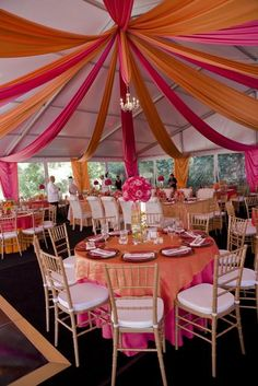 We love color! Pink and Orange set the mood for a bright and fun wedding!