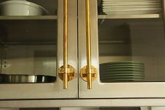 """""""The cabinet hardware in my office is made of unlacquered (so it will tarnish) brass plumbing parts."""" - Erica McPherson Powell"""