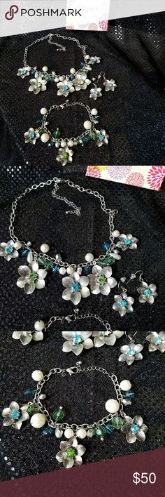 Necklace, bracelet and earrings set. Silver floral motif with aqua, teal and green accents. Premier Designs Jewelry Necklaces