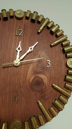 This bullet casing clock is handmade from start to finish. All casings used have been fired through a personal firearm either personally or by my significant other. The clock base is 11 in diameter made out of 3/4 wood with a Red Chestnut wood stain. Please note that wood grain patterns and knots will vary from base to base. Stain colors may look slightly different than what is portrayed on your monitor. You can choose to change the stain to any of the Minwax choices in the fifth photo... Bullet Casing Crafts, Bullet Casing Jewelry, Bullet Crafts, Diy Furniture Projects, Diy Wood Projects, Wood Furniture, Shotgun Shell Crafts, Shotgun Shells, Significant Other Gifts
