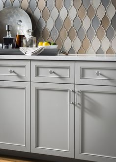 Lydia Knobs from Top Knobs Serene Collection and the tile backsplash are perfect!