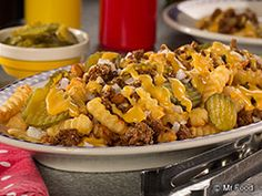 This hearty version of Cheesy Burger Fries offers all the tempting tastes of a juicy cheeseburger and fries combo, but you'll need a fork to enjoy them! It's perfect for a party or just for a fun and novel weeknight meal!