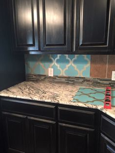 Peel and stick wallpaper for a backsplash - *maybe not this combination but an interesting idea to spruce the place up temporarily until a better option can be afforded