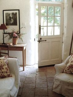 Chalky lime white walls, old quarry tiles and washed out ivory linen. Simple fresh country interior. R McN.