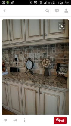 exactly what i refinished to a custom off white finish with heavy glaze and oh that backsplash diy home by photo from