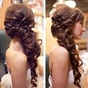 Another loose, pulled-apart side braid. Great for a gown with less detail and/or beading, or one with a lower neckline.