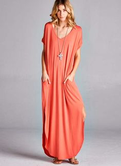 Maxi dress with side pockets and side slits. Oversized fit, model wearing small. Made from 95% rayon, 5% spandex.