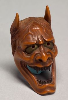 Japan, Hannya Mask Netsuke, boxwood, c. 19th century. The Hannya (般若) mask is a mask used in Japanese Noh theater, representing a jealous female demon or serpent.