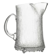 iittala Ultima Thule Ice Lip Pitcher In modern literature, Ultima Thule is used to reference the furthest possible place in the world. Tapio Wirkkala's Ultima Thule glassware similarly references the icy cold reaches of Scandinaiva and t. Lappland, Serveware, Tableware, Kitchenware, Water Carafe, Glass Pitchers, Glass Vase, Glass Design, Glass