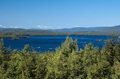 "Photo of Lake Winnipesaukee and the Ossipee Mountains, New Hampshire. Credit: Don Kasak; Wikimedia Commons. Read more on the GenealogyBank blog: ""New Hampshire Archives: 75 Newspapers for Genealogy Research."" http://blog.genealogybank.com/new-hampshire-archives-75-newspapers-for-genealogy-research.html"
