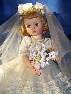 Gorgeous All Original Madame Alexander Elise Bride ~ I have Elise in a bride's maid dress.  She has black hair & a pink dress.