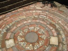 Collect old bricks and stones to make a mosaic patio...cheap and stunning!