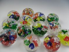 Lots of colorful five lily paperweights