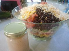 Barbeque Ranch Chicken Salad! Easy quick dish to throw together on a budget! Black beans, diced tomatoes, corn, cheese, grilled chicken or pulled chicken. Use store bought Ranch or homemade and add some Sweet baby Rays to make the Barbeque Ranch dressing! Great dish for a potluck!