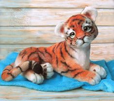 Tiger felted Elias, the toy is made of wool