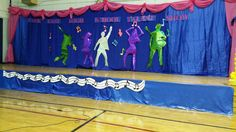 This was for a Talent Show celebration at a High School.  It was a mix of some of other Pinterest projects ideas and myself. I hung up some curtains, made valances with panels and added some 5 foot dancing silhouettes with musical notes