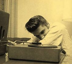 ♡♥Elvis 21 plays a record in 1956 - click on pic to hear Elvis sing 'True Love Travels on a Gravel Road' 2:36♥♡