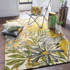 Floreale Maize Rugs 44206 by Harlequin features an impressive floral design with green and grey colour palette for an opulent addition to your interior.
