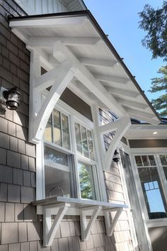 Lake Home craftsman exterior. Add architectural details and interest to the si… Lake Home craftsman exterior. Add architectural details and interest to the side windows. Craftsman Windows, Craftsman Exterior, Craftsman Style Homes, Craftsman Bungalows, Exterior Doors, Craftsman Porch, Corbels Exterior, Craftsman Houses, Diy Exterior