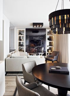 Living room with black hints and neutrals. Visit houseandleisure.co.za for more