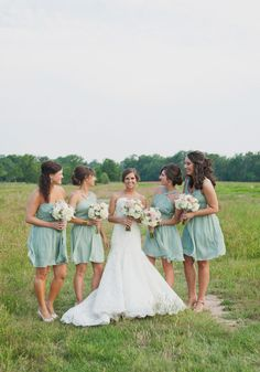 bridesmaids in seafoam dresses // photo by @Christa Vickers Elyce   Dresses a little too short for January...