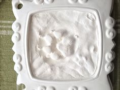 Made my dogs paw print with a plaster kit for a baby handprint at Hobby Lobby $9.99