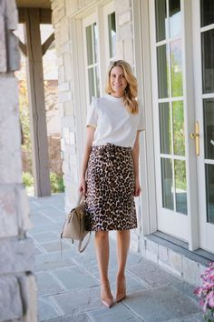 My outfit details: Rachel Parcell Top, J.Crew Leopard Print Skirt, Louboutin Pumps, Celine Bag (similar here & here) When I found this skirt, I knew I needed it! I love leopard print and the … Leopard Print Outfits, Animal Print Outfits, Leopard Print Skirt, Leopard Dress, Animal Print Fashion, Printed Skirt Outfit, Printed Skirts, Skirt Outfits, Maxi Dresses