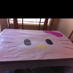 DIY hello kitty table cloth (I'm guessing markers and white dollar store table cloth would work!)