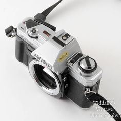 Minolta X-300 35mm SLR Film Camera Body with Auto 200X Flash, Neck Strap, Instructions & Body Cap - Working VGC