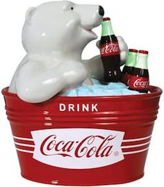 From the Coca-Cola Collection, it's the Coca-Cola Polar Bear Cookie Jar! This ceramic cookie jar measures 9 tall, and features the polar bear from the Coca-Cola commercials sipping a Coke from inside a red ice bucket that reads, Drink Coca-Cola. Vintage Coca Cola, Ceramic Cookie Jar, Cookie Jars, Cookie Containers, Pepsi, Coca Cola Commercial, Coca Cola Kitchen, Coca Cola Polar Bear, Coca Cola Christmas