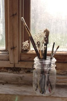window, jar and paintbrushes..