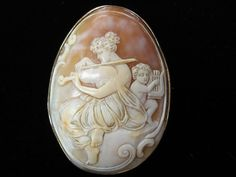 Large musical cameo chatelaine pin