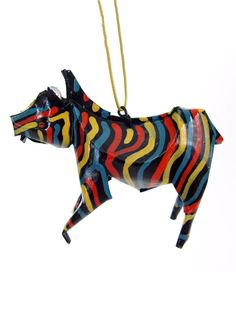 """Zebra Ornament.  $12.00. The zebra teaches us the beauty in individuality. The zebra's distinctive stripes serve as a protective camouflage against predators. This dynamic animal helps us to both maintain our individuality and be supportive members of our communities. The stripes also represent integration of opposites, enabling us to see a deeper truth.    Height: 2.5""""   Length: 3.5""""   Width: 1""""  Artist: Daniel Thomas, painted by Khumbalani Muraga  Made In: Zimbabwe"""