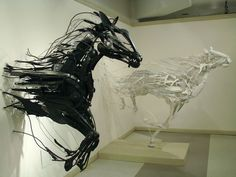 i absolutely love these Sculptures of horses running; they really embody the movement of horses running by almost showing their trail  as they are running.