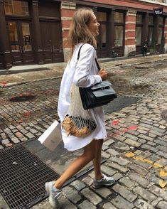 woven fishnet shopper bag / fashion white long dress shirt and sneakers / minimalist style /