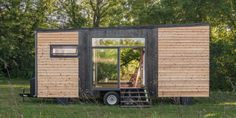 The sleek design by New Frontier Tiny Homes features a farmhouse sink, shiplap and subway tile squeezed into 200 square feet. Best of all, though, a sliding glass garage door reveals a deck that pops out from the home, making al fresco dining a cinch.
